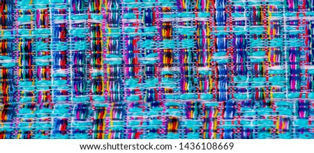Background texture, pattern. Winter fabric, warm. big braided thread. Blue-red yellow threads. This photo will make your design the best. Wallpapers, pictures, posters. #1436108669