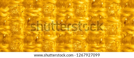 Background texture, pattern. Yellow fabric with metallic sequins. This beautiful lightweight sequined fabric has notes, sequined accents and a beautiful design. It also has a nice sheen. #1267927099