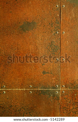 background texture, rusty steel with rivets