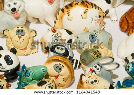 Background texture. Template. Products made of clay, folk crafts. Refractory products made of clay. hard, sticky fine-grained earth, usually yellow, and dried and baked to make and pottery. #1164341548
