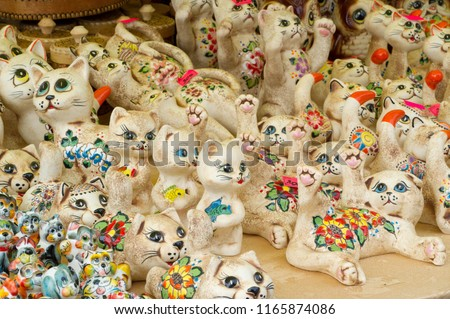 Background texture. Template. Products made of clay, folk crafts. Refractory products made of clay. hard, sticky fine-grained earth, usually yellow, and dried and baked to make and pottery.