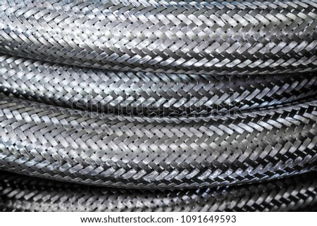 Background / Textures of Metal wire braided stainless flexible hose