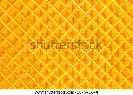 Background tiles with gold-colored oil. - stock photo