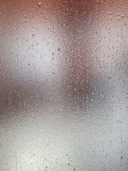 background translucent fogged glass misted through which bright light breaks