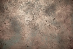 Background wall with abstract spots. Beautiful brown, bronze texture with stains, abstract surface background, modern bright painting of walls in trending shades, unusual spotty silver and gold surfac