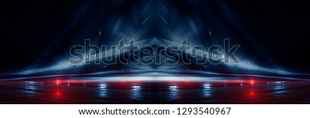 Background wall with neon lines and rays. Background of an empty dark corridor, parking, airport with neon light. Abstract background with lines and glow. Wet asphalt, the reflection of neon lights in