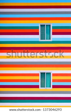 Background walls of bright colored buildings with fire escape / bright colored buildings / doors and windows on the side of the building