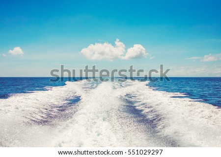 Background water surface behind of fast moving motor boat in vintage retro style #551029297