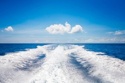 Background water surface behind of fast moving motor boat. Vacation holiday concept background wallpaper.