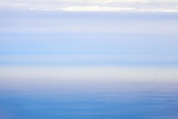 background, waterscape - the sea in the distance merges with the sky in the morning fog