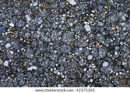 Background with a pebble and stones of grey color - stock photo
