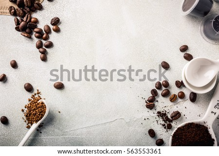 Background with assorted coffee, coffee beans, ground and instant, pads and capsules, retro style toned, copy space, top view. #563553361