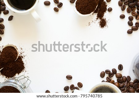 Background with assorted coffee: cups of espresso, coffee beans, powder and capsuleson white baclground. Space for copy. Top view. Flat lay