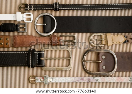 background with belts - stock photo