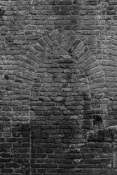 Background with brick wall grown with mos and ancient medieval window shape