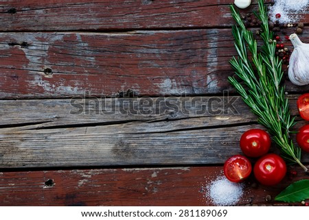 Background with bunch of herbs and spices on rustic wooden texture. Cooking, vegetarian food or health concept. Space for text.