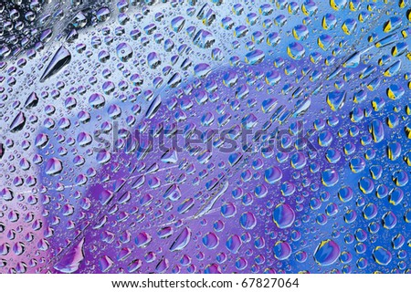 Background with  color water drop. Rain drop on the glass