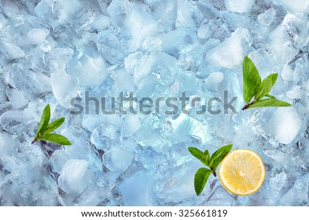 background with crushed ice cubes mint and lemon, top view