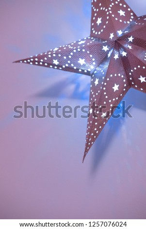 Background with decorative star.  Decorative star with lamps on violet background. Christmas concept. #1257076024