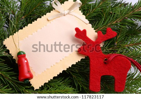 Background with fir and greeting card