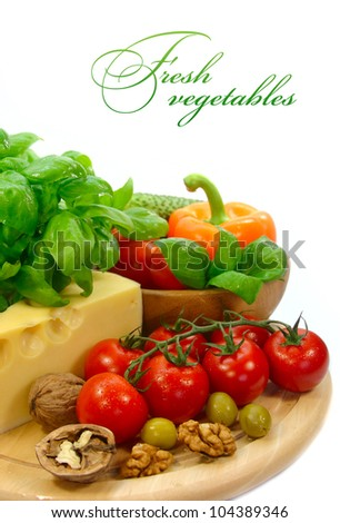 background with fresh vegetables and cheese on white background