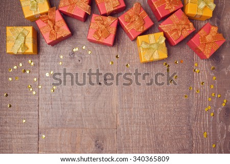 Background with gift boxes on wooden table. Sale and discount concept. View from above