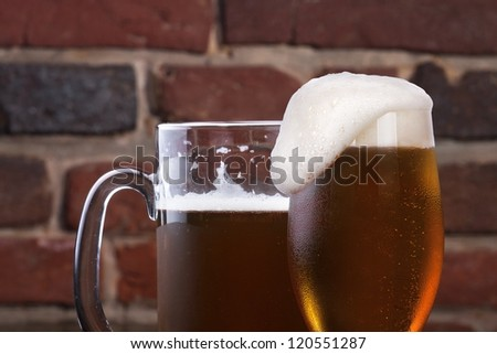 background with Glass of light beer on a dark pub