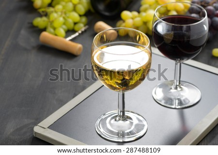 background with glasses of red and white wine, horizontal