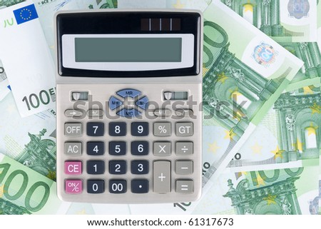Background with hundred euro banknotes and calculator. - stock photo