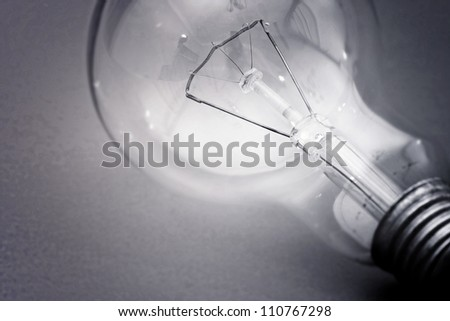 Background with lit lightbulb. Isolated on green