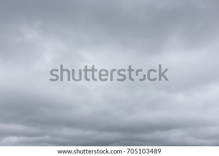 Background with low dark gray clouds cover the whole sky