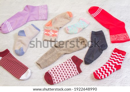 Background with many socks. National Sock day or Odd Socks Day background design element. Bright multi-colored socks for women and children.