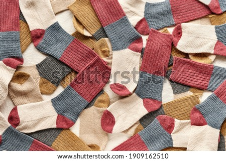 Background with many socks. National Sock day or Odd Socks Day background design element. Matching socks are joy
