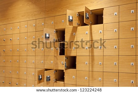 Background with many wooden lockers, some locked, some open