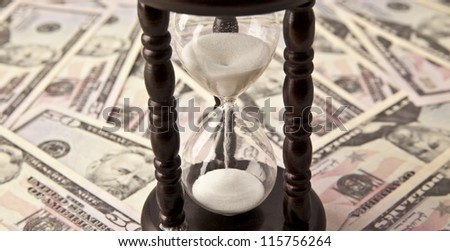 Background with money american hundred dollar and hourglass - stock photo