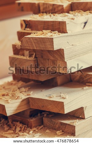 background with planks of wood shavings. wood construction material for background and texture. Wood processing. Joinery work. wooden furniture. timber structure background, small depth of field 商業照片 ©