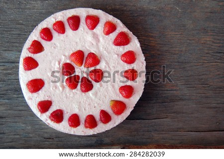 background with raw strawberry cake on rustic wooden table