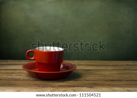 Background with red coffee cup on wooden table