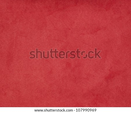 Background with red texture, velvet fabric, full frame, close-up