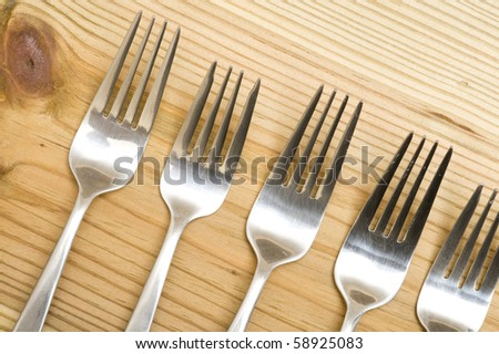 Background with silverware. Kitchen utensil on wood background