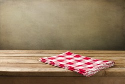 Background with tablecloth and wooden deck table over grunge background