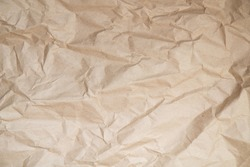 Background with the texture of uniformly crumpled Kraft paper.