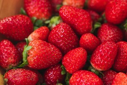 background with various beautiful and juicy strawberries