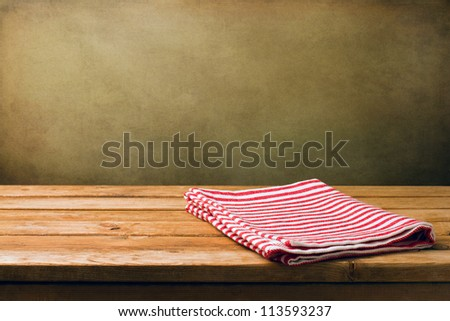 Background with wooden deck tabletop and grunge wall