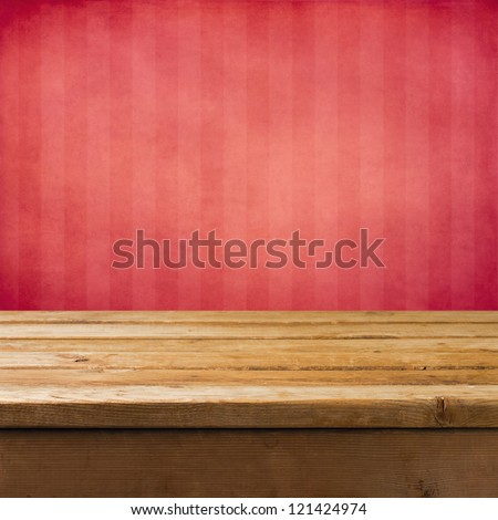 Background with wooden table and pink grunge striped wall