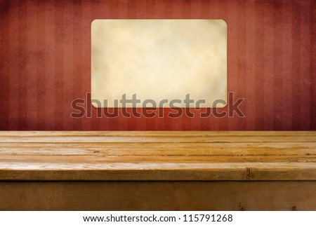 Background with wooden table and red grunge wall with strips