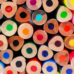 Background wooden colored pencils. Design concept. Selective focus.