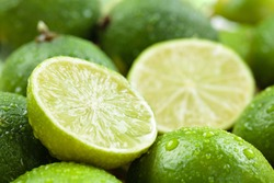 Backgrounds. Close up shot of wet  limes. Focus on the central part of sliced lime.