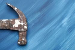 Backgrounds - Grungey antique claw hammer on streaky blue white background.