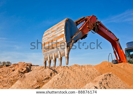 Backhoe Digging Sand at a Sand Quarry